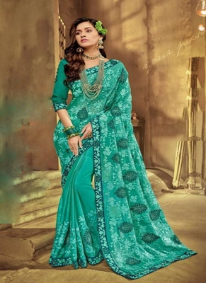 Turquoise embroidered fancy fabric saree with blouse