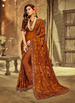 rust embroidered fancy fabric saree with blouse