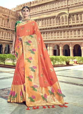 Peach woven patola saree with blouse