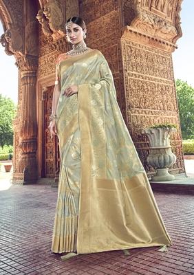 light grey woven patola saree with blouse