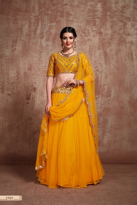 Mustard embroidered net unstitched lehenga