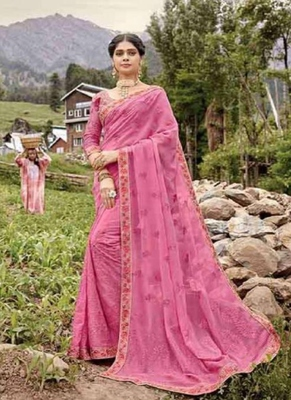 light pink embroidered fancy fabric saree with blouse