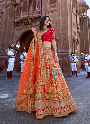 Orange thread embroidery silk semi stitched lehenga