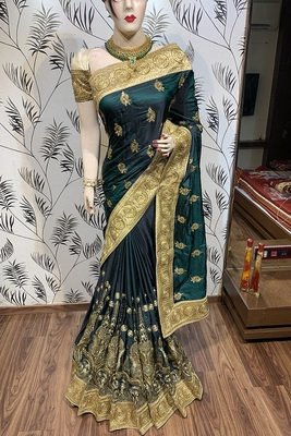 Green embroidered faux raw silk saree with blouse