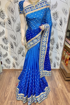Blue embroidered faux raw silk saree with blouse