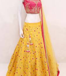 Yellow embroidered satin semi stitched lehenga