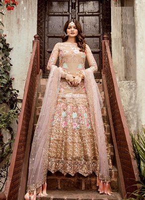 Cream embroidered net salwar