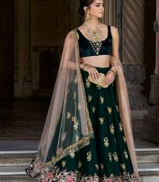 Dark-green embroidered velvet semi stitched lehenga