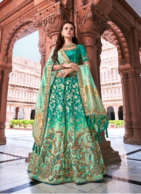 Teal thread embroidery silk semi stitched lehenga