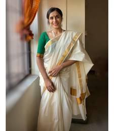 kasavu saree with golden border.