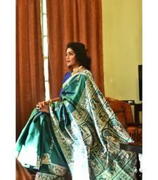 Royal, majestic Baluchari saree in a dual tone of blue-green