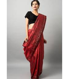 The beautiful Baluchari weave looks absolutely stunning in this maroon avatar