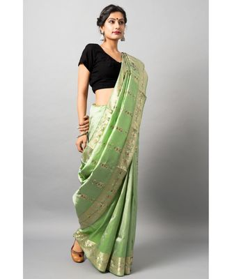 The beautiful Baluchari weave looks absolutely stunning in this mint avatar