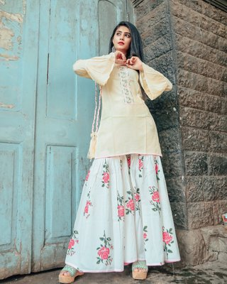 Cream Hand Embroidered Kurta Set With This Beautiful Potli
