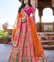 Rani-pink embroidered silk semi stitched lehenga
