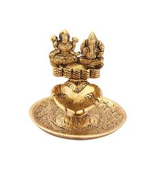 Lakshmi Ganesh hand diya in metal antique gold plated