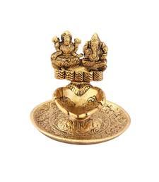 Lakshmi Ganesh hand diya in metal antique gold plated