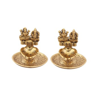Lakshmi Ganesh hand diya pair in metal antique gold plated
