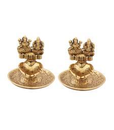 Lakshmi Ganesh hand diya pair in metal antique gold plated