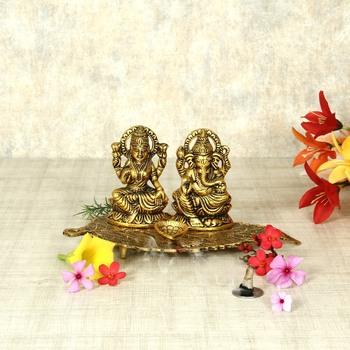 Handicrafts Paradise Laxmi Ganesh  on Leaf  with Diya - Lord Ganesha Metal Hand Craved for Home Decorative Gift Puja