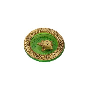 Tortoise incense holder placed in Green glass vessel with metal border