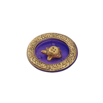 Tortoise incense holder placed in Purple glass vessel with metal border
