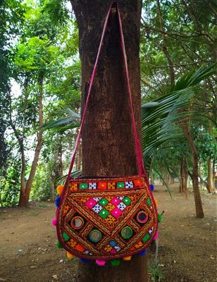 Real Mirror Worked Matka Shaped Kutch Embroidered Banjara Jhola Bag With Multicolored Pompoms All Around