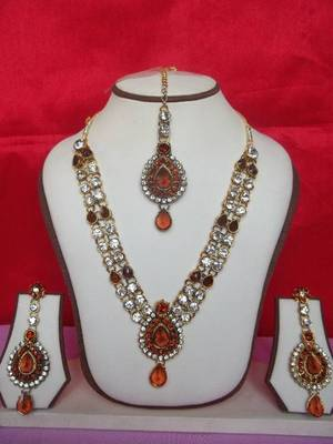 indian bridal orange stone studded set with matching earrings and maang teeka