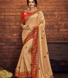 Cream embroidered satin saree with blouse
