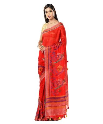 Red linen ensemble with tassels saree