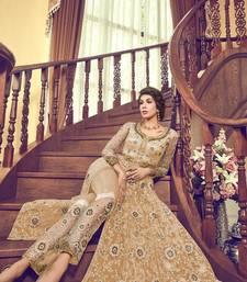 Beige thread embroidery net salwar