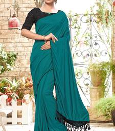 Turquoise plain silk saree with blouse