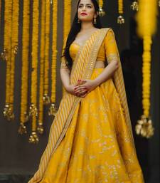 Yellow thread embroidery silk semi stitched lehenga