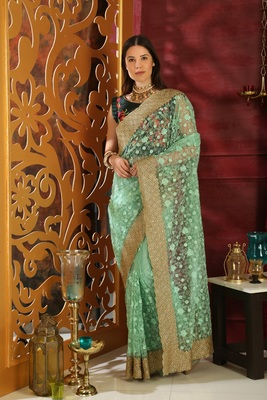 Light green embroidered organza saree with blouse
