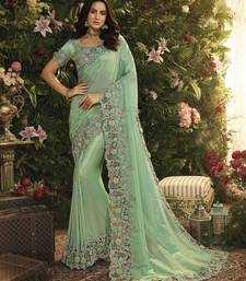 Turquoise Embroidered Pure Tissue Saree With Blouse