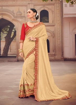 Cream embroidered silk saree with blouse