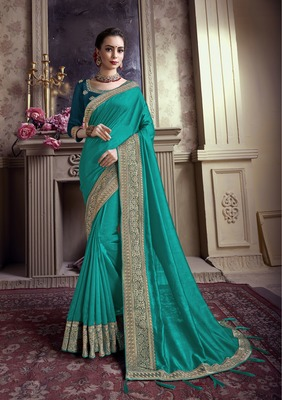 Dark turquoise embroidered chiffon saree with blouse