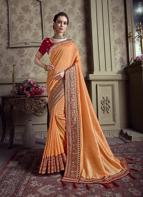 Orange embroidered chiffon saree with blouse