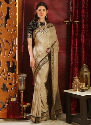 Beige brasso silk saree with blouse