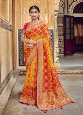 Orange woven silk saree with blouse
