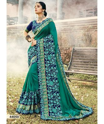 turquoise embroidered silk blend saree with blouse