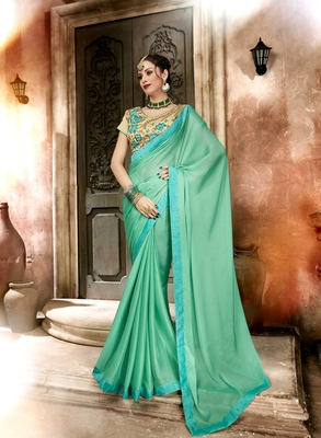 Green embroidered georgette saree with blouse