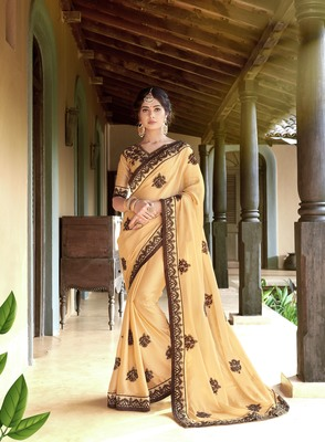 Cream embroidered georgette saree with blouse