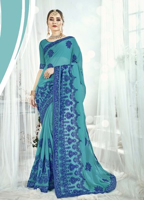 Sea green embroidered satin saree with blouse