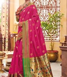 Pink woven paithani silk saree with blouse