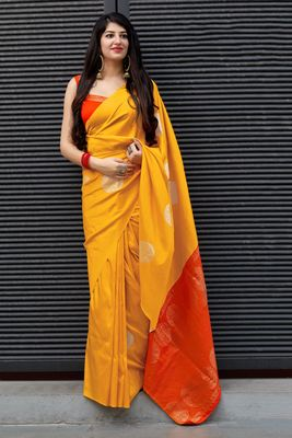 Yellow woven banarasi silk saree with blouse