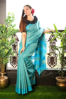 SKY BLUE BLENDED MATKA SAREE WITH ALLOVER GOLDEN PRINTED BUTA