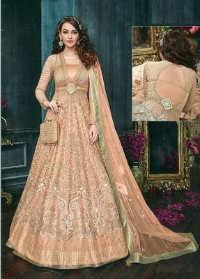 Orange embroidered Net semi stitched salwar with dupatta