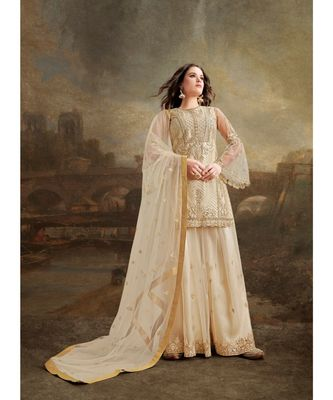 Cream embroidered Net salwar with dupatta