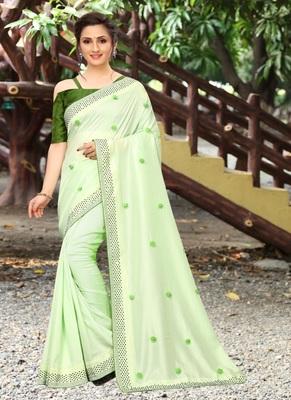 Parrot green plain silk saree with blouse